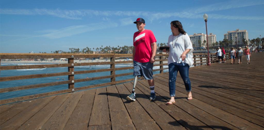 Infinite TF user and woman walking on boardwalk